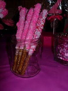 Hmmm...white chocolate pretzles with pink sprinkles?