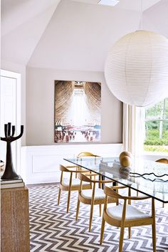 White walls, dining table, dining chair, chevron floor