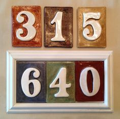 House numbers. Can be vertical or horizontal. Select tile color or mix and match tiles. Concealed mount holes on weatherproof poly panel.