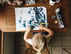 making beautiful messes - little girl painting with watercolor paints