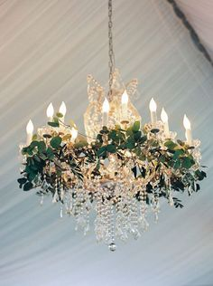 Wow! Gorgeous chandelier with greenery! | 22 Gorgeous Ideas for a Modern Woodland Wedding | Brit + Co