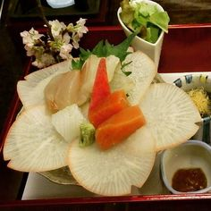 Beautiful radish petals and sashimi with miso condiment.
