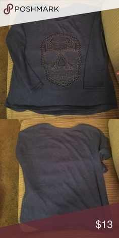 Wet Seal royal blue skull sweater sz M Gently worn ladies royal blue lightweight sweater sz M, the sleeves go a little bit past elbows. The skull is made from black & silver small beads (they are all intact ) I washed and dried it since I got it and none fell off Tops Blouses