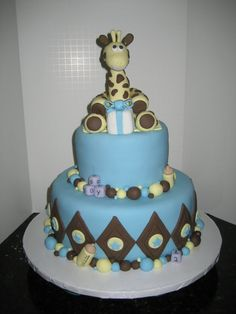 Blue, Brown and Yellow Baby Shower Cake with Diamonds  Stars and a Giraffe Topper