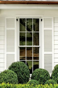 Shutters and Siding in Benjamin Moore Swiss Coffee - Stylish Window Shutters - Southernliving. Long six-over-six windows without transoms keep the look sleek. Pairing the windows with slender, three-banded louvered shutters is both pretty and practical. They're less prone to warping and stronger than shutters with fewer bands.   The siding, shutters, and trim are painted Swiss Coffee by Benjamin Moore.