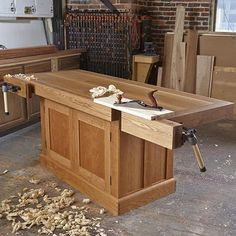 What a great workbench this is. Veritas quick-release tail vise and face vise. White oak top. Cherry cabinet with drawers. We have two in the WOOD shop. I want to make one for my own shop.