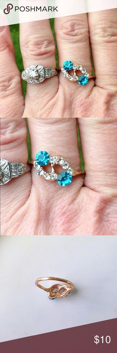 Vintage Bright Teal Simulated Aquamarine Ring  Cute gold tone vintage ring with two vibrant teal faux aquamarine stones accented with sparkly clear rhinestones. Stones are clear and catch light beautifully! Size is close to 7.5-8. Vintage Jewelry Rings