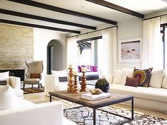 Western Interiors by designer Kara Mann. House in San Jose del Cabo with neutral interiors, vibrant pops of color and eye catching ethnic textiles.