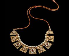 Indian gold necklace inspired from tribal jewellery. Description by Pinner Mahua Roy Chowdhury