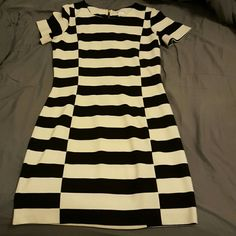 Club Monaco beautiful black/white striped dress Purchased on poshmark as NWOT, which seems accurate - excellent condition.  Unfortunately,  the dress does not fit me. It's pretty form fitting and might fit a size 6 better or a size 8 who likes clothes a bit tighter. Just trying to recoup my money. Club Monaco Dresses