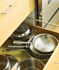 Create a cooking zone around the stove, storing pots and pans as close to the range as possible.