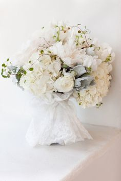 Mainly white and ivory bouquet with a touch of silver-sage lamb's ear foliage.