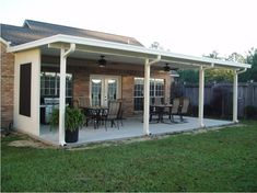 What I like about this image: the porch roof is similar to what we would like to install over our back patio.