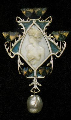 An Art Nouveau Nymph and Poppies pendant, by René Lalique, circa 1900-02. Signed LALIQUE. Gold, ivory, enamel, glass and pearl. 6.2 x 4.9cm.