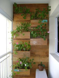 Be creative with how you place your flowers and potted plants on your balcony. Make use of the walls as not only places to hang frames but as actual flower pots too. They can save a lot of space and provide a very artistic look.