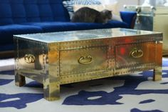 Google Image Result for http://www.stylebyemilyhenderson.com/storage/gold%2520trunk%2520coffee%2520table%2520emily%2520henderson.jpg%3F__SQUARESPACE_CACHEVERSION%3D1327683179437