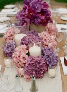 Lavender and purple hydrangea with some softer mauve toned roses surrounding candles. Lovely as centerpieces.