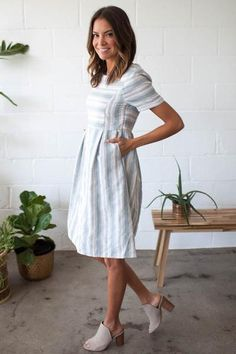 Our Eucalyptus Dress features a scoop neckline, vertical and horizontal stripe print, and side inset pockets. 100% Cotton Lined 65% Polyester 36% Cotton Hand wash cold, hang or line dry Size & Fit Fit: This garment fits true to size Length: Size Small/Medium measures 36'' from shoulder to hem Model Info Height: 5'9'' Wearing size: Small