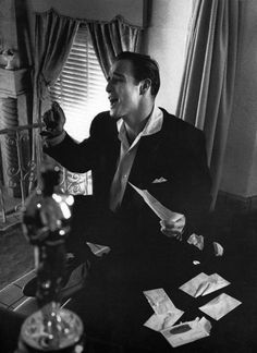 "Marlon Brando with his Oscar for ""On The Waterfront"" in the foreground, photo by Phil Stern"