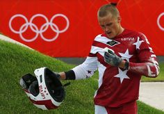 Injured Olympians: Blood, bruises and tears - Latvia's Edzus Treimanis bleeds after crashing his bike during the men's BMX seeding run during the London 2012 Olympic Games at the BMX Track in the Olympic Park August 8, 2012. REUTERS/Cathal McNaughton