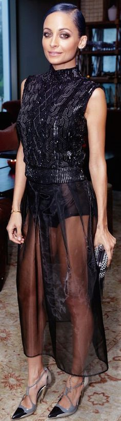 Nicole Richie wearing a black sequin and crystal cable knit top with a black sheer skirt and Balenciaga heels