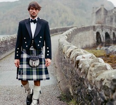 I'm a Gordon! (note Eilean Donan in the background if you can stop looking at the sexy model in the Gordon plaid)