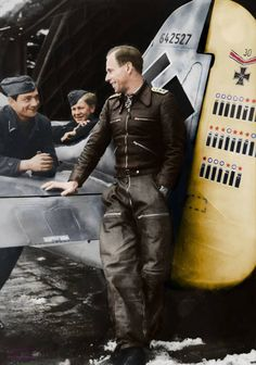 """Addi Glunz stands beside his Fw 190A-7 W.Nr. 642 527 """"White 9"""" on 22 February 1944. Photographed at Cambrai-Epinoy.colorized photo ."""