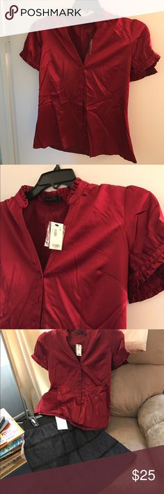 Dark berry ruffled blouse. Feminine button up blouse with a v-neck and ruffled collar and sleeves.  Beautiful berry color. 96% poly 4% spandex. Size s, never worn, new with tags. Smoke free home. The Limited Tops Blouses
