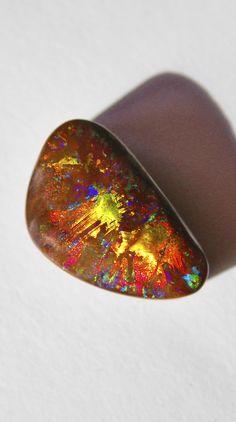"""Boulder Opal, """"Sunburst"""" Bill Kasso 47mm x 30mm. Skin of a Yowah Nut"""