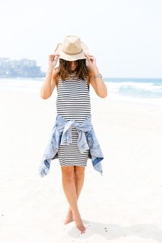 Black and white striped dress, jean jacket and a straw hat.