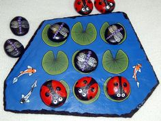 Make & play outdoor tic tac toe Tic Tac Toe Board, Outdoor Acrylic Paint, Painted Rocks Kids, Painted Stones, Rock Painting Ideas Easy, How To Make Paint, Game Pieces, Pebble Art, Board Games