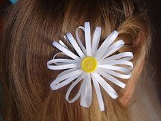 Easy flower tons of tutorials on this site for hair bows etc.