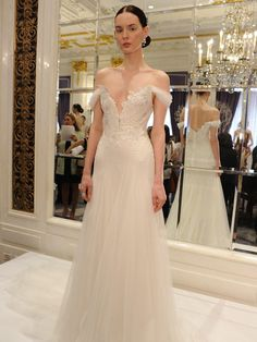 Marchesa modified A-line tulle gown with lace appliqué and off-shoulder gathered tulle sleeve