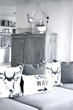 Grey. White. Living room. Scandinavian interior design.