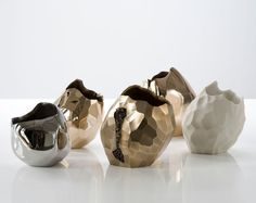 David Wiseman. Stainless Steel, Bronze and Porcelain Vases Rock...