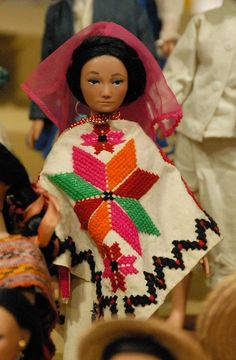 Mexican Costume Doll embroidered quechquemitl cape. Similar capes are worn by Nahua women from Cuatlamayan, Tancanhuitz, San Luis Potosi state, Mexico