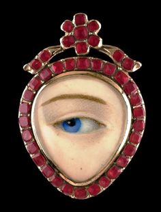 Heart-shaped Georgian lover's eye ring surrounded with Hessonite garnets. The reverese is embroidered and contains hairwork, ca.1790.