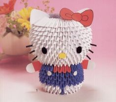 Cute Hello Kitty and friends made of 3D origami. If you want the diagrams to make any of them, you can request it at origamimaniacs@gma...