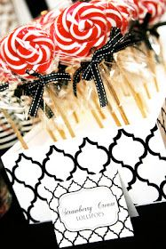 The bold black and white pattern showcases the red and white Lollypops! Great for any event. Could be used as a table centerpiece or candy bar.