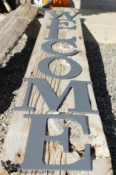 BUILD: Make a huge Welcome sign with reclaimed wood or a large wood board--- add letters to make a sign for the front porch. HUGE Front Porch Welcome Sign - The Wood Grain Cottage Barn Wood Crafts, Barn Wood Projects, Reclaimed Wood Projects, Outdoor Projects, Diy Projects, Outdoor Decor, Outdoor Signs, Porch Welcome Sign, Bois Diy