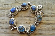 This stunning bracelet is made of solid 925 sterling silver and 7 genuine labradorite gemstones.