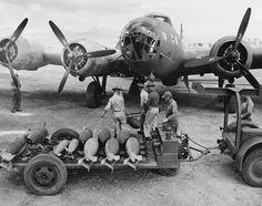 An ordnance crew loading 300 pound bombs into a U.S. Air Force bomber, Hawaii, 1942.