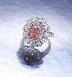 A fancy colored diamond and diamond ring set with a cut-cornered rectangular-cut fancy intense pink diamond, weighing 3.56 carats, within a pear-shaped diamond surround, further enhanced by pavé-set diamond surround, gallery and shoulders Round Diamond Engagement Rings, Engagement Ring Styles, Diamond Rings, Diamond Jewelry, Colored Diamonds, Pink Diamonds, Brighton Jewelry, Pear Shaped Diamond, Diamond Gemstone