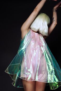 Pvc babydoll dress with an asymetric bob haircut. 60s meets 90s in an iridescent pastel shimmer.