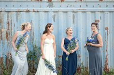 mismatched blue bridesmaid dresses and I love the flowers!!!