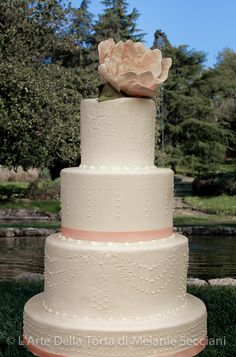 Tuscany Wedding cake by L'Arte Della Torta di Melanie Secciani in Florence, Italy. Pearls and Silk. The inspiration for this cake came from the couture inspired raw silk finish on the fondant and hand piped beading. Timelessly elegant, there's no other word for this design, except pretty. Piped pearls dropping down in strands, wrapping themselves around the tiers, remind every woman that we were all little girls who loved to dress up in our mothers pearls.
