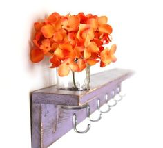 I love this idea of the jar of flowers being built in to the wood rack (actually if you just make a hole it just sits in there).