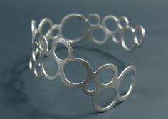 This silver cuff has evolved from the Totem collection, in response to new approaches to making. # jewellery #jewelry @VickyForrester_