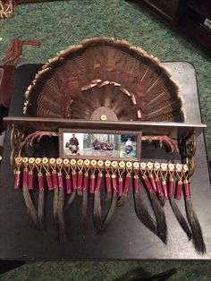 Turkey beard, fan, and spur display from recycled shelf and shotgun shells