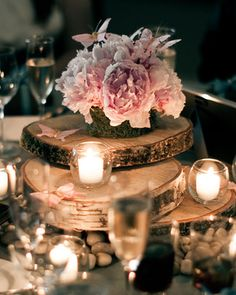 autumn centrepiece, table decor with wood, candlelight and flowers